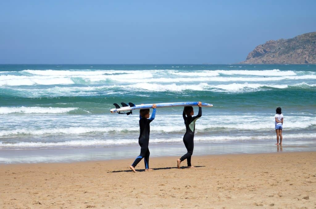 Little surfers at Praia do Guincho near Cascais, Portugal | Perfect beach trip from Lisbon