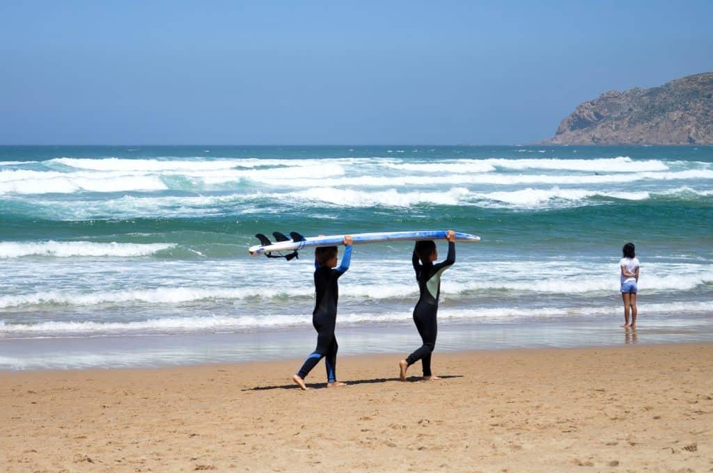 Little surfers at Praia do Guincho near Cascais, Portugal | Perfect beach trip from Lisbon