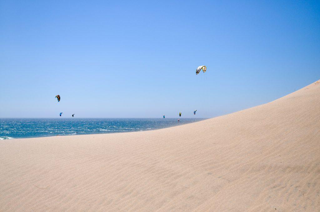 Kitesurfers at Praia do Guincho near Cascais, Portugal | The perfect beach trip from Lisbon