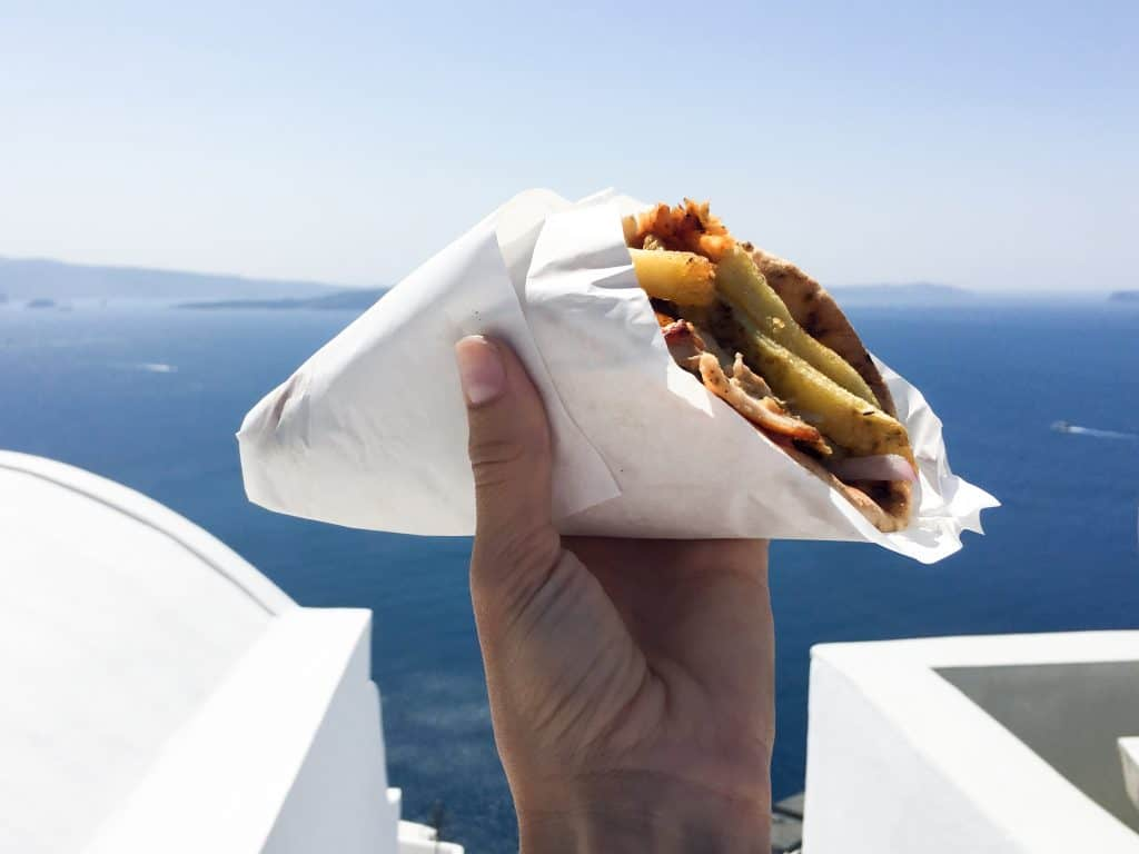 Top 10 Things to Do in Santorini, Greece   Get off the beaten path with a cliff walk from Fira to Oia, go cliff jumping, and eat €2 gyros.