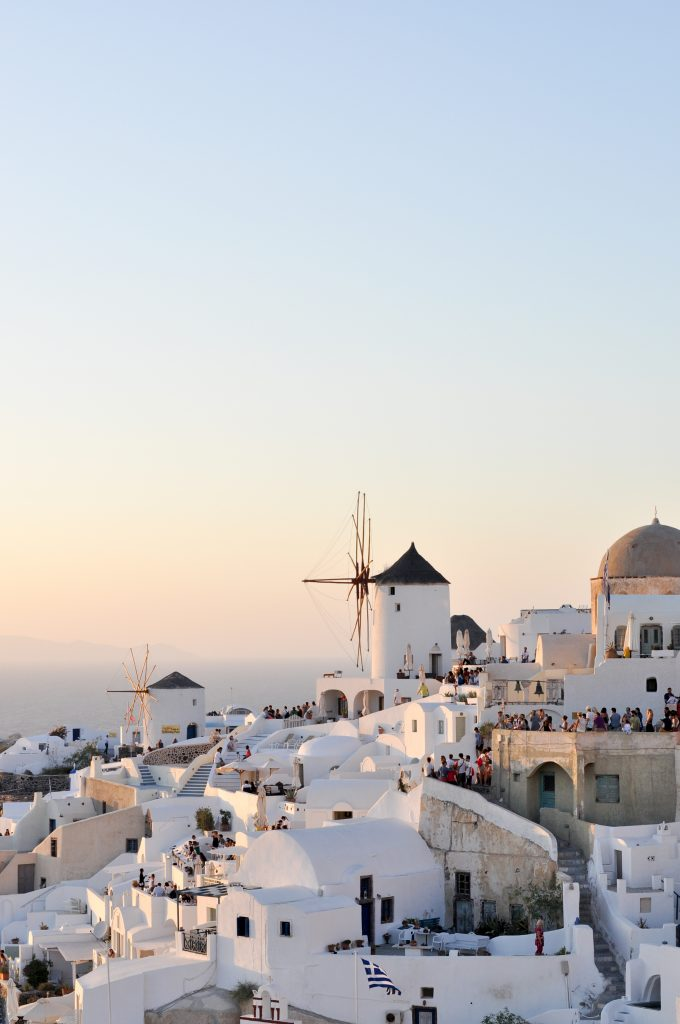 Oia, Santorini |  Top 10 Things to Do in Santorini, Greece | Get off the beaten path with a cliff walk from Fira to Oia, go cliff jumping, and eat €2 gyros.