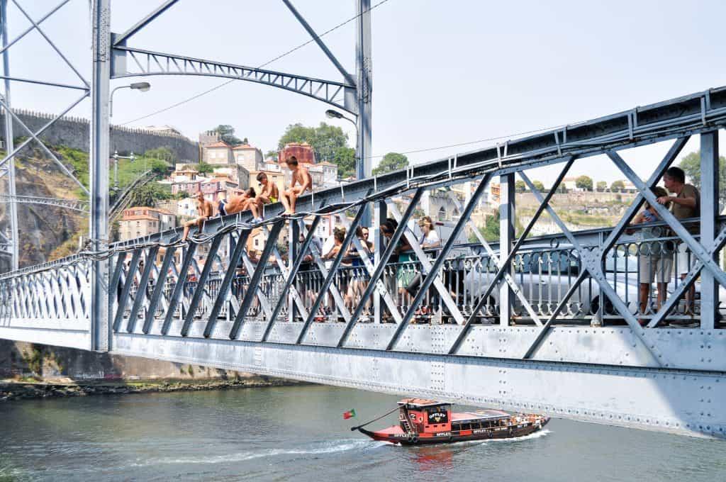 Kids jumping into the Douro River   Exploring Portugal: Lisbon vs Porto  