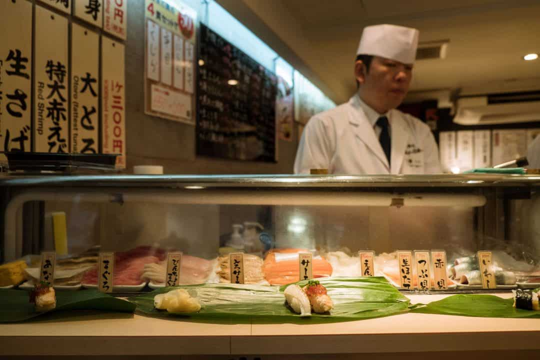 The Best Japanese Street Food in Tokyo's Shibuya Neighborhood   A Tokyo Food Tour with Arigato Food Tours   Eating at a Standing Sushi Bar