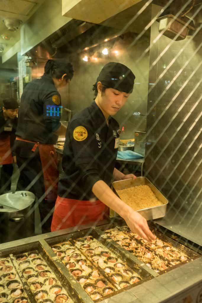 The Best Japanese Street Food in Tokyo's Shibuya Neighborhood | A Tokyo Food Tour with Arigato Food Tours | Making Takoyaki