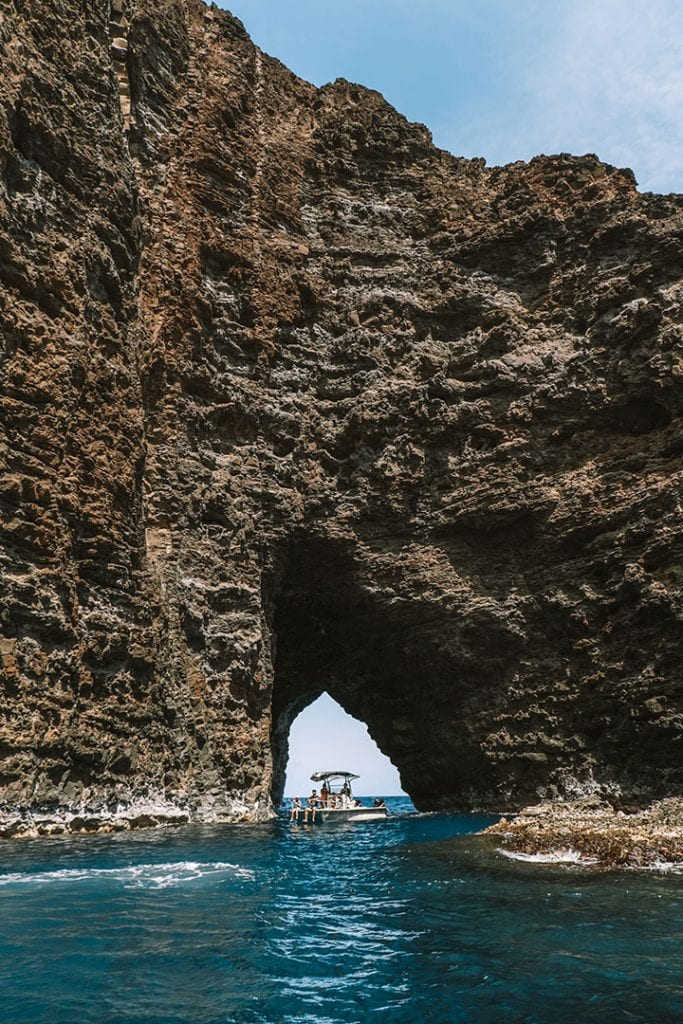 Boat going through Sea Cave along Kauai's Na Pali Coast