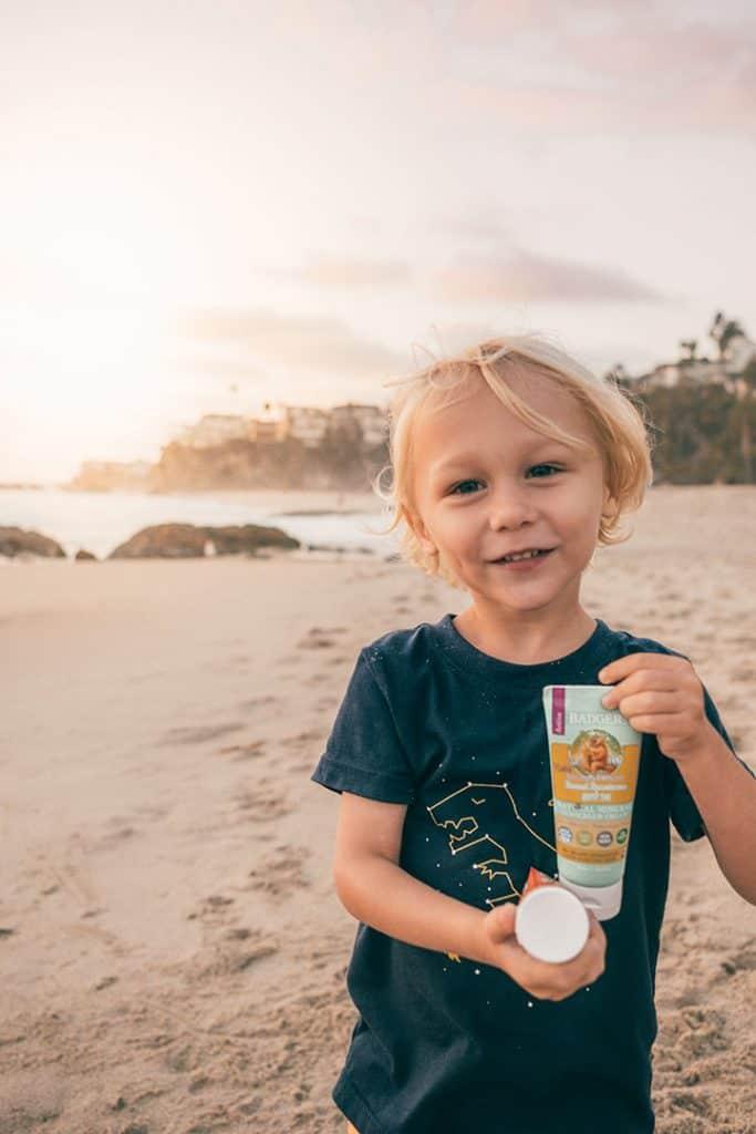 Boy holding Kids Badger Suncreen on the Beach | Natural Reef-Safe Sunscreen