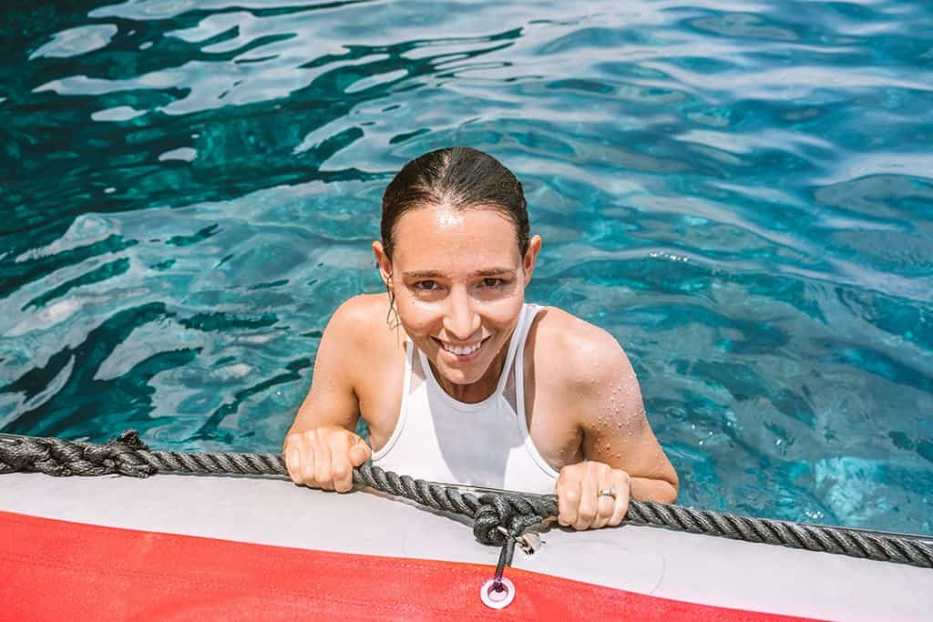 Girl wearing Raw Elements Reef Safe Sunscreen in water along Kauai's Na Pali Coast
