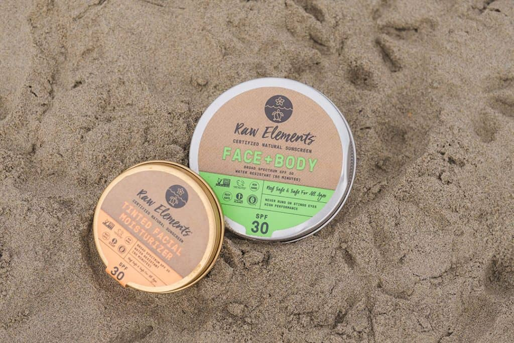 Tins of Raw Elements Reef-Safe Sunscreen