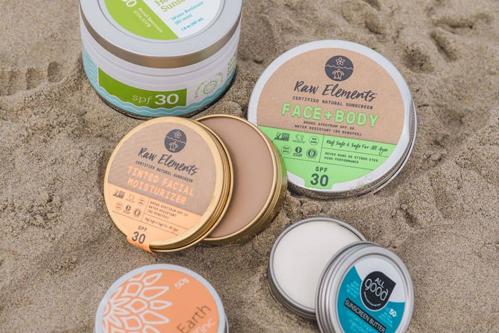Tins of the best reef-safe sunscreen | Brands like Butterbean Organics, Raw Elements and All Good make natural, zinc oxide sunscreen that is safe for coral reefs