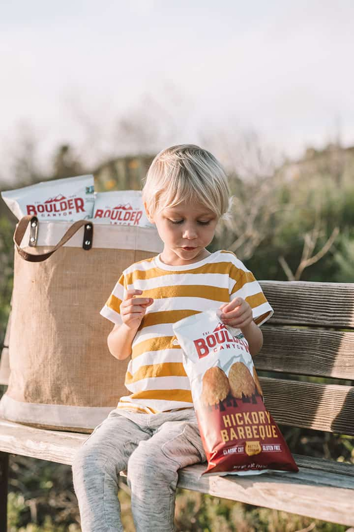 Child eating Boulder Canyon Potato Chips