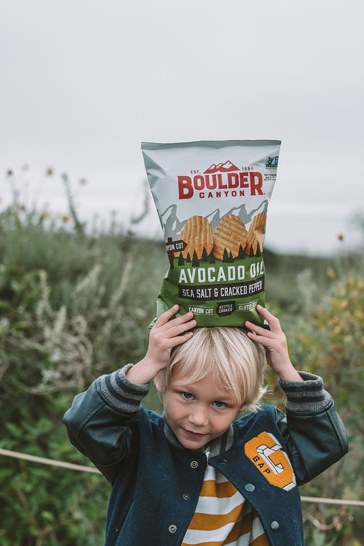 Child holding Boulder Canyon Potato Chips