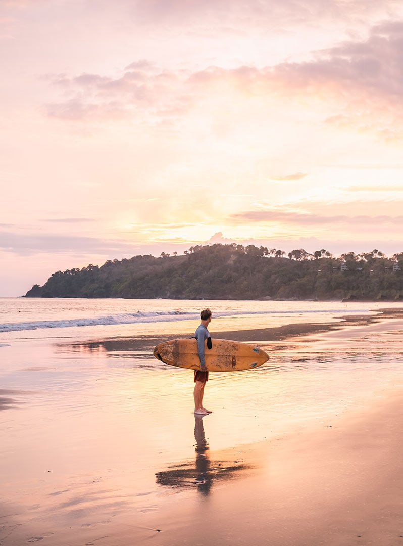Surfing at Playa Espadilla right outside of Manuel Antonio National Park in Costa Rica