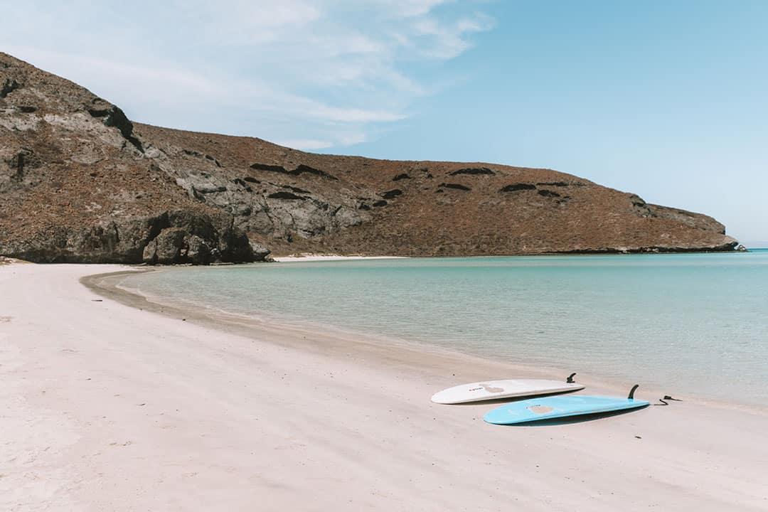 SUP boards on an empty stretch of beach at Balandra Beach