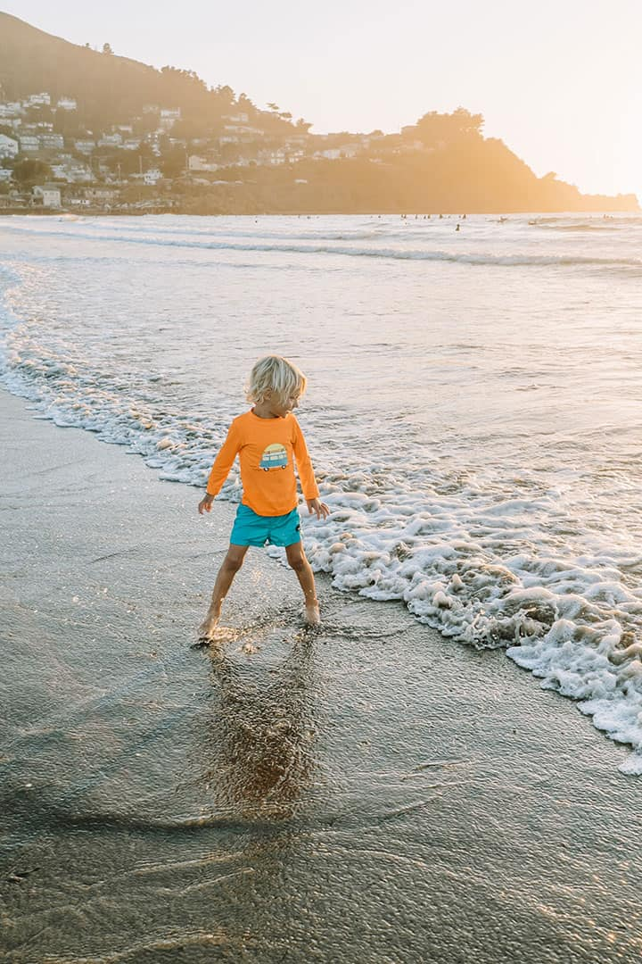 Child playing in the ocean at Pacifica Beach
