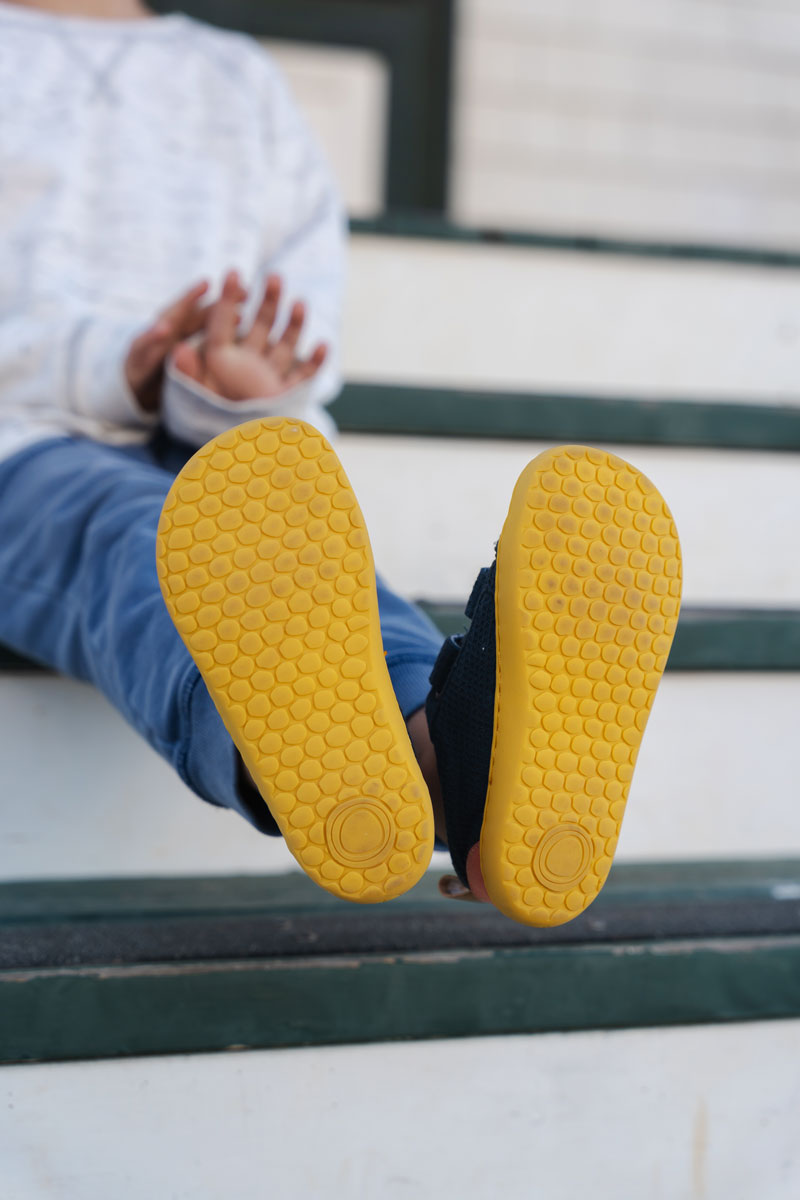 The soles of barefoot shoes for kids are foot shaped and flexible