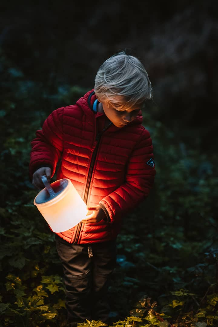 Carrying the Luci Light, a solar powered lantern for camping