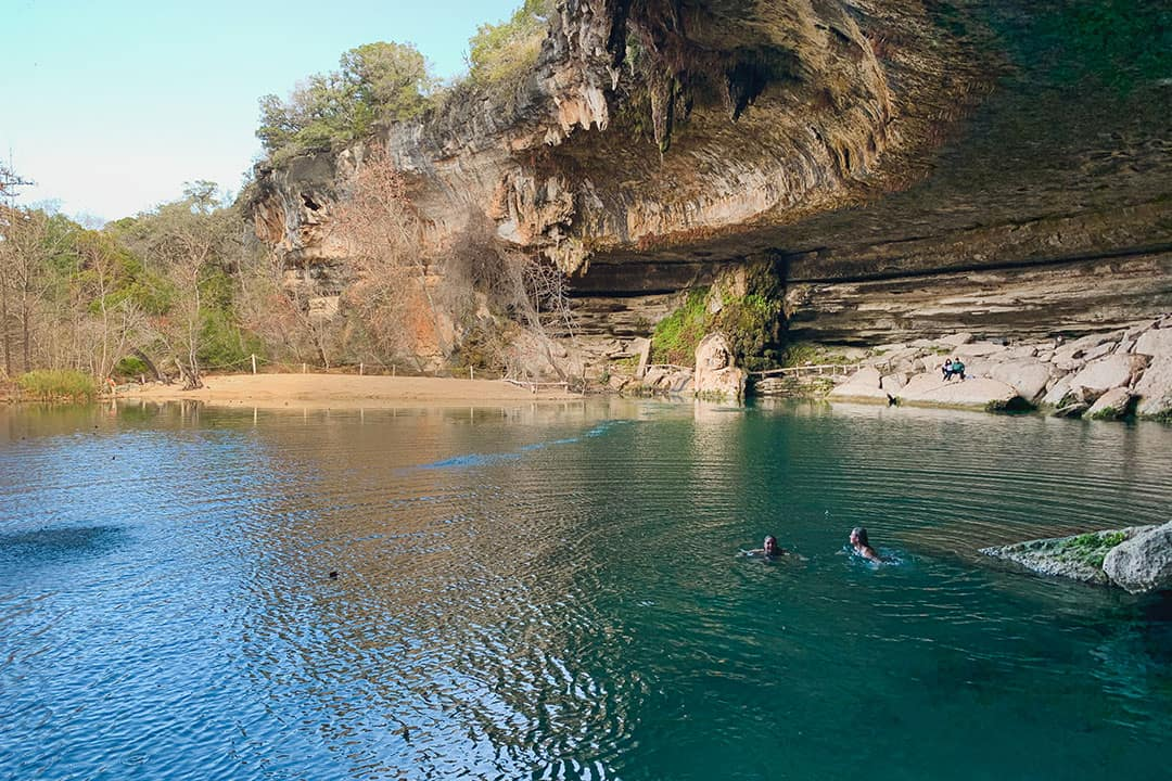 Swimming at Hamilton Pool preserve near Austin, Texas
