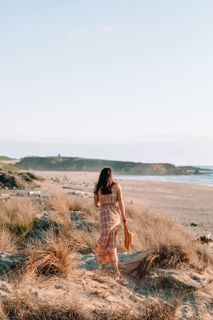 Walking along the beach in a Maxi dress by Toad & Co, a sustainable outdoor apparel company