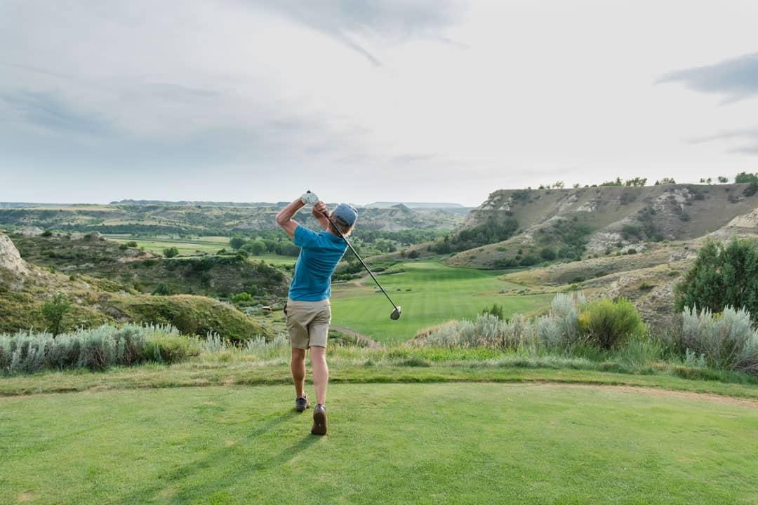 Golfer at Bully Pulpit Golf Course in Medora, North Dakota