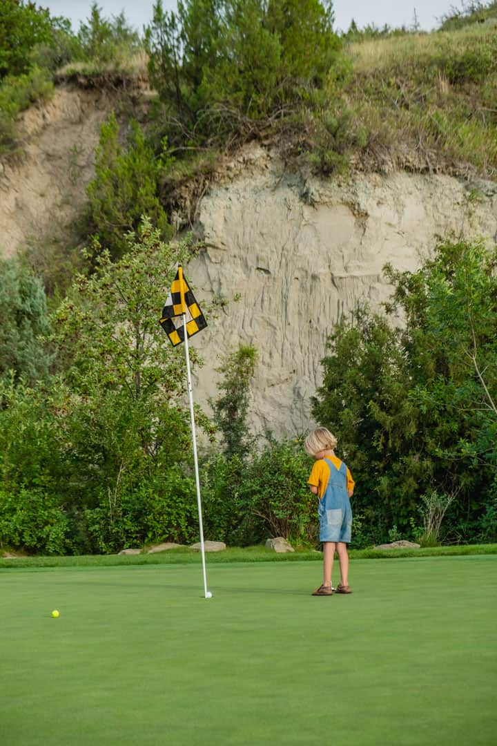 Child Putting at Bully Pulpit Golf Course in Medora, North Dakota