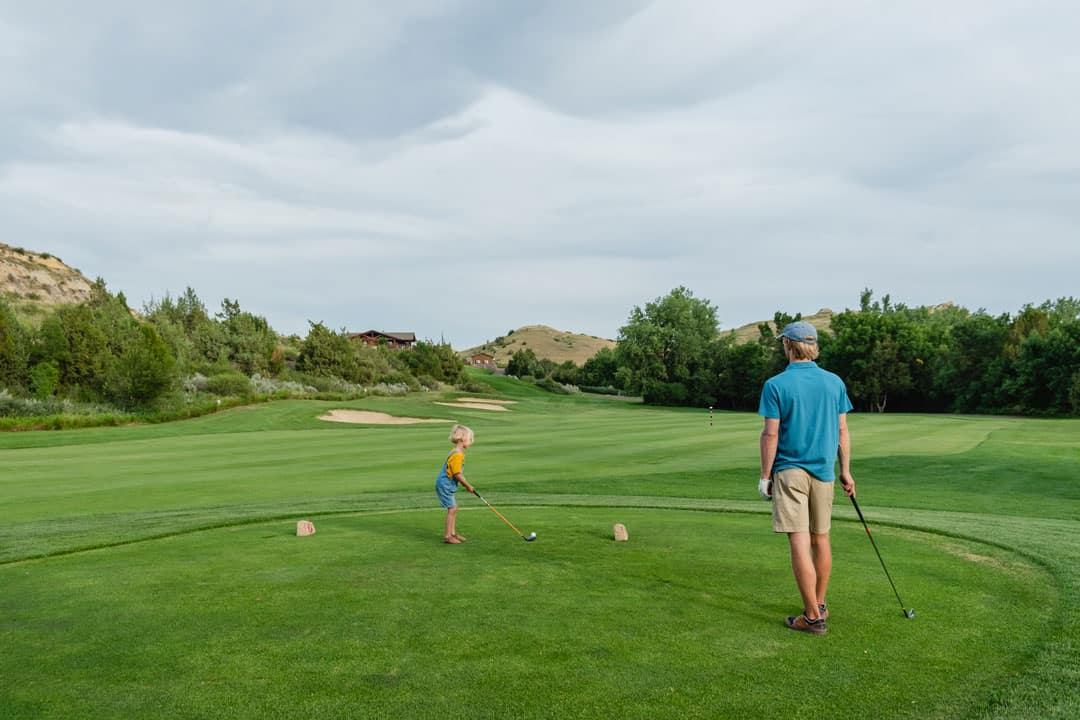 Golfers at Bully Pulpit Golf Course in Medora, North Dakota