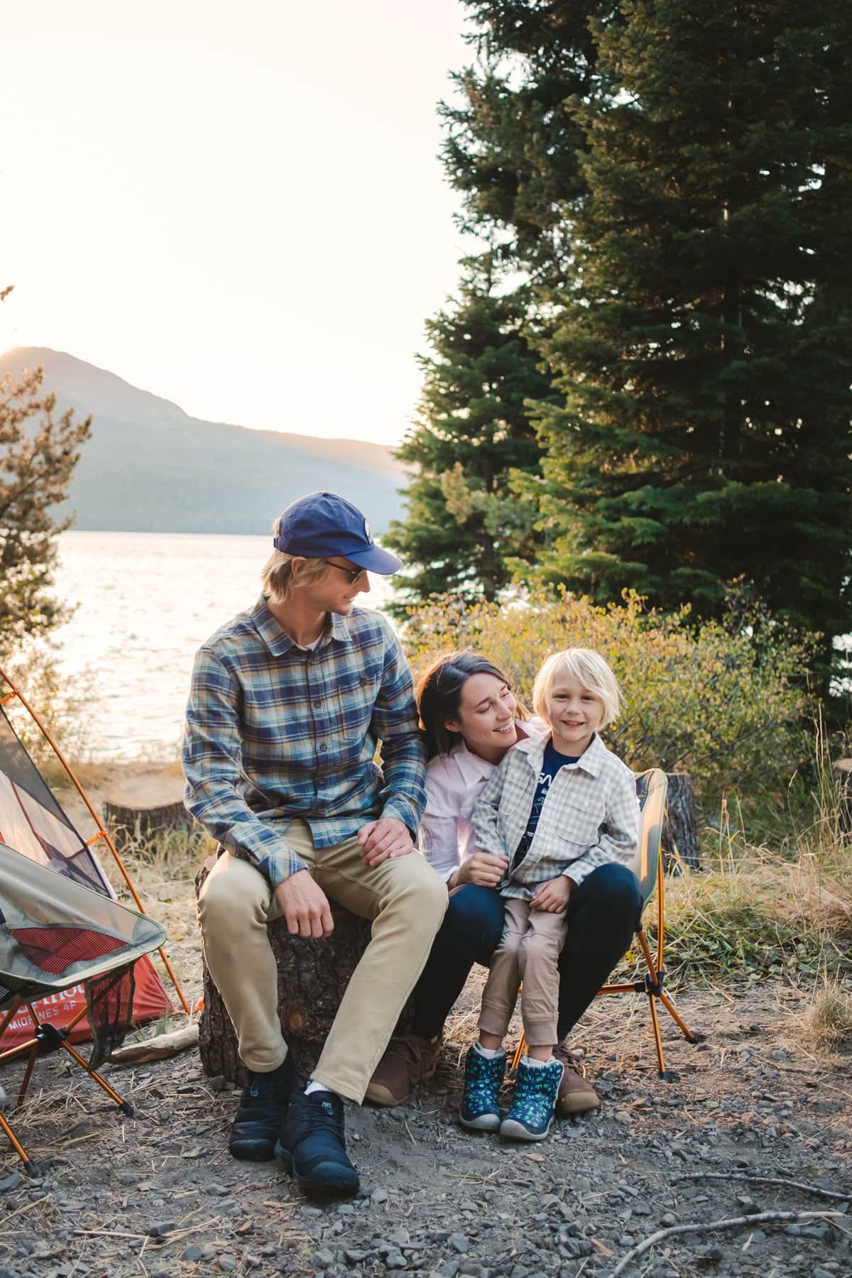 Family wearing the KEEN Howser boots and chukkas while camping